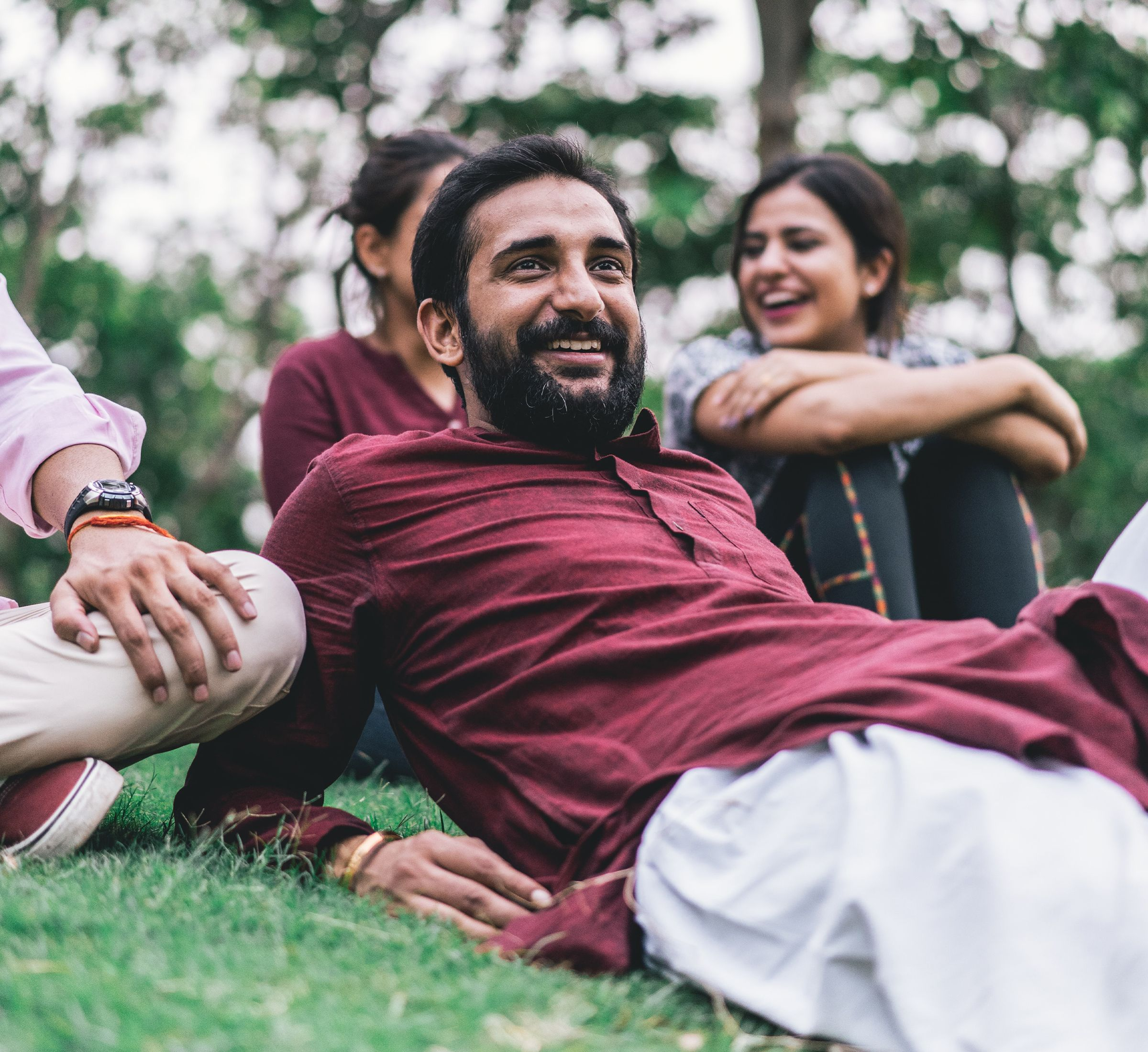 happy man on grass with family